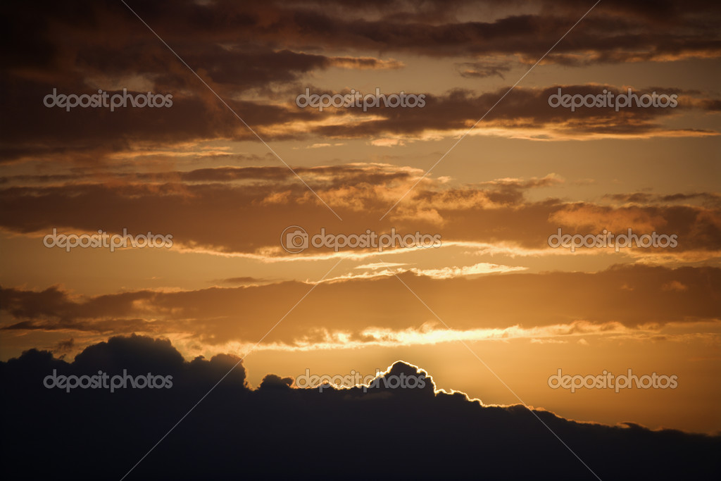 Golden sunset with glowing cloud edges in Maui, Hawaii, USA.  Stock Photo #9432244
