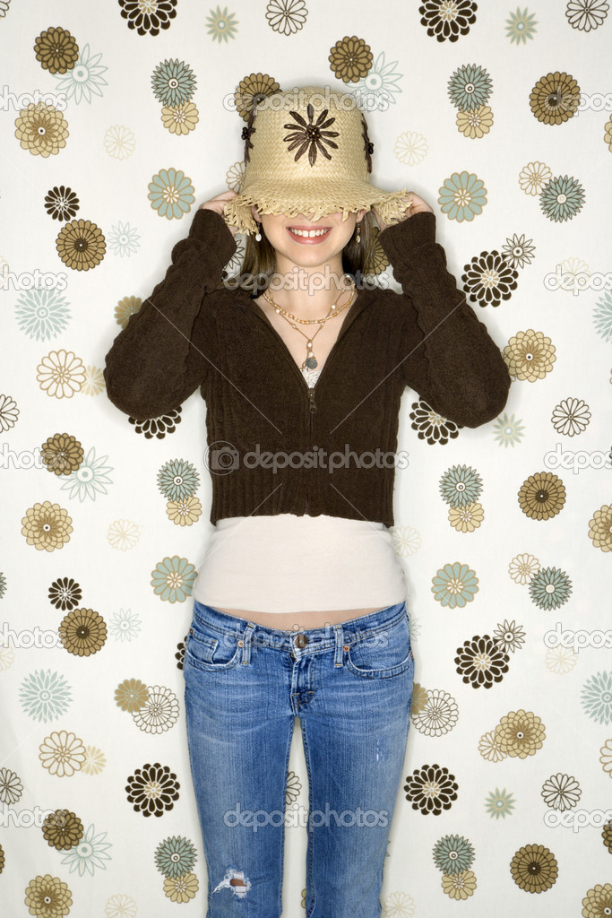 Caucasian adolescent female pulling hat over eyes. — Stock Photo #9433815