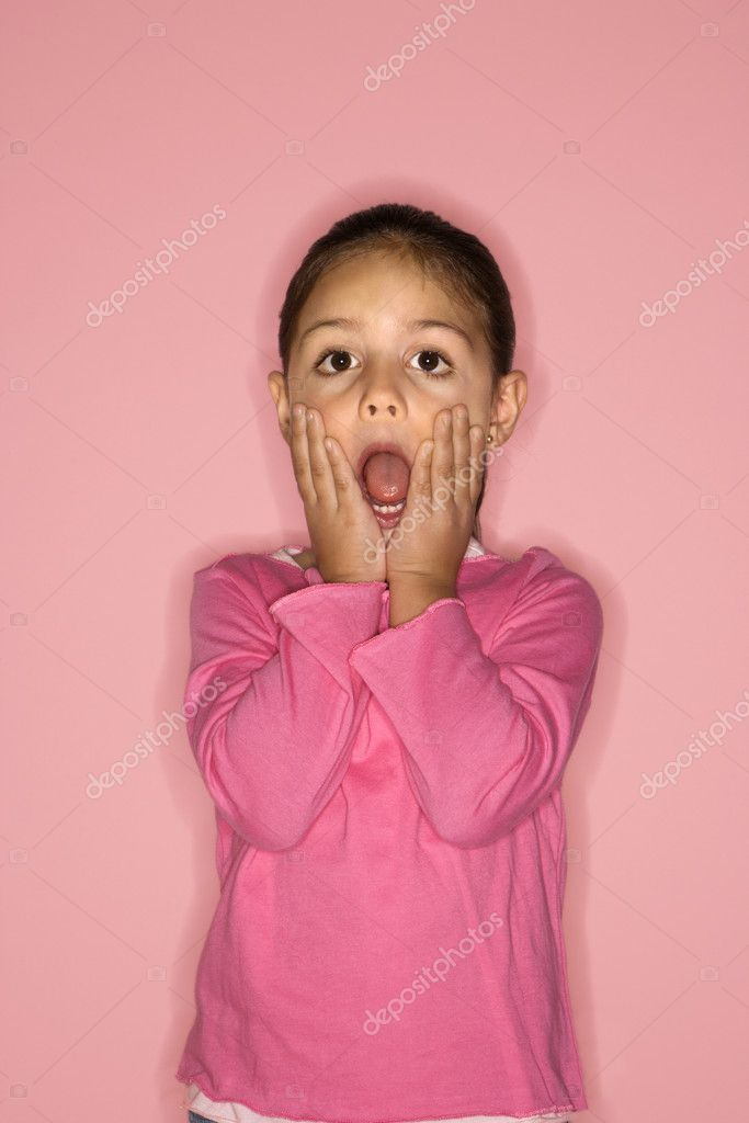 Female Hispanic girl with hands on face and mouth open. — Stock Photo #9433838
