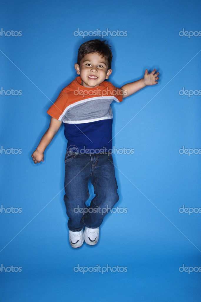 Male Hispanic boy jumping. — Stock Photo #9433843
