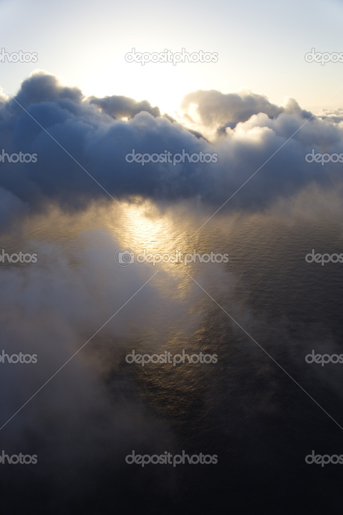 View from above the clouds with Pacific ocean underneath. — Stock Photo #9434784