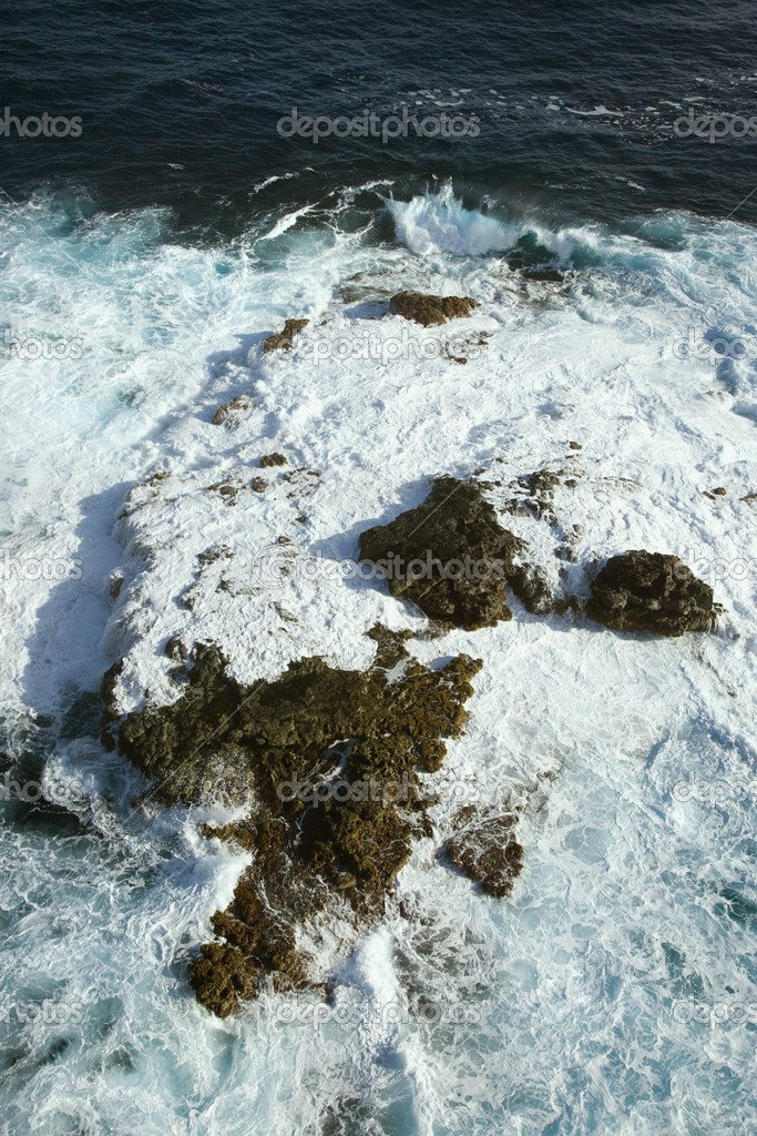 Aerial view of rocks in Pacific ocean with water swirling around them off the coast of Maui, Hawaii.  Stock Photo #9434824
