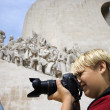 Stock Photo: Boy photographing.