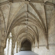 Arched Exterior Hallway of Monastery of Jeronimos - Stock Photo