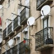 Royalty-Free Stock Photo: Apartment satellite dishes.
