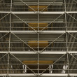 Scaffolding around structure. - Stok fotoğraf