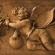 Foto Stock: Carving of cherub angel.