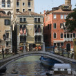 Bridge over Venice canal. - Stock Photo