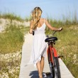 Girl Walking Bike on Boardwalk - Foto de Stock