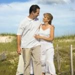 Couple walking to beach. — Stock Photo #9498049