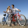 Couple with Bikes at the Beach — Stock Photo