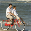 Dad riding bike with son . — Stock Photo