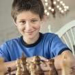 Boy playing chess. - Stok fotoğraf