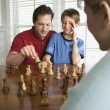 Dad teaching chess to son. — Stock Photo