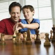 Stock Photo: Dad teaching chess to son.