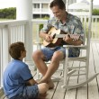 Father and Son on Porch - Stock Photo