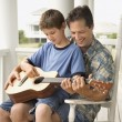 Royalty-Free Stock Photo: Father and Son Playing Guitar