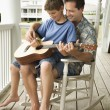 Father and Son Playing Guitar — Stock Photo #9498148
