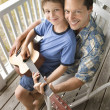Father and Son on Porch Playing Guitar — Stock Photo