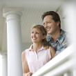 Couple on Porch of Home — Stock Photo