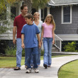 Stock Photo: Family of four walking.