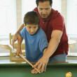 Stock Photo: Father and Son Playing Pool