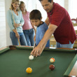 Stock Photo: Family Playing Pool