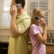 Man and Young Girl on Phones — Stock Photo #9498268