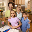 Family portrait in kitchen. - Stockfoto