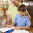 Stock Photo: Father Helping Son with Homework