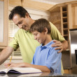 Father Helping Son with Homework — Stock Photo