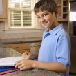 Boy doing homework. — Stock Photo