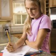 Girl doing homework. — Stockfoto