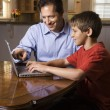 Man and Young Boy on Laptop — Stockfoto