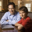 Man and Young Boy with Laptop — Stock Photo #9498283