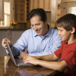 Man and Young Boy on Laptop — Stock Photo