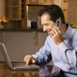 Man on Cell Phone and Laptop — Stock Photo
