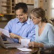 Couple Paying Bills Online - Stock Photo