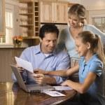 Family on computer. — Stock Photo