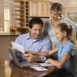Family on computer. — Stock Photo