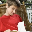 Boy reading book. — Stock Photo