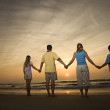 Family holding hands on beach — Stock Photo