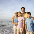 Stock Photo: Smiling family on beach.