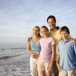 Smiling family on beach. — Stockfoto