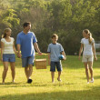 Family walking in park. - Foto Stock