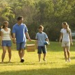 Family walking in park. - Stockfoto