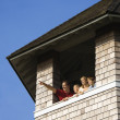 Family Looking Out Tower Window — Stock Photo