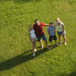Family standing on lawn. — Stock Photo #9498432