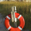 Life preserver hanging on post. — Stock Photo #9498568