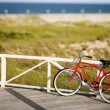 Red beach cruiser bicycle. - ストック写真
